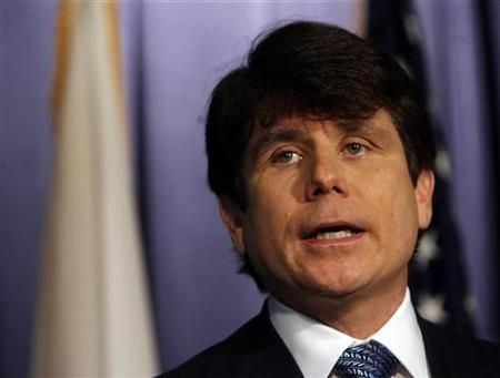 Governor Rod Blagojevich of Illinois addresses questions about charges brought against him of conspiracy and bribery, including allegations he was seeking to benefit financially from his appointment of a successor to the U.S. Senate seat that was vacated by President-elect Barack Obama during a news conference in Chicago, December 19, 2008. REUTERS/Jeff Haynes