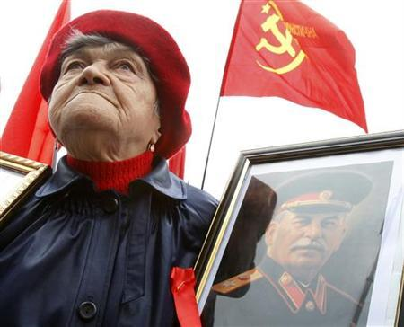 A Ukrainian communist supporter holds a portrait of Soviet dictator Josef Stalin during a May Day demonstration in central Kiev, May 1, 2008. REUTERS/Gleb Garanich