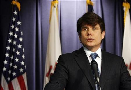 Governor Rod Blagojevich of Illinois addresses questions about charges brought against him of conspiracy and bribery, including allegations he was seeking to benefit financially from his appointment of a successor to the Senate seat that was vacated by President-elect Barack Obama during a news conference in Chicago, December 19, 2008. REUTERS/Jeff Haynes