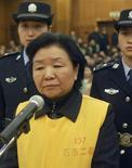 <p>Salnu Group, davanti ai giudici del tribunale di Shijiazhuang, il 31 dicembre 2008. REUTERS/China Daily</p>