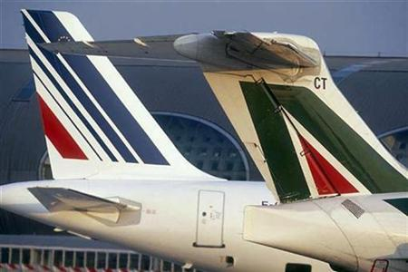 Air France (L) and Alitalia aircrafts are seen in Paris in this undated handout photo. REUTERS/Air France/Handout