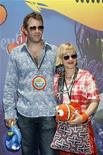 "<p>Actress Patricia Arquette and her husband Thomas Jane pose as celebrities and their kids arrive for a preview of the new ""Finding Nemo Submarine Voyage"" attraction at Disneyland in Anaheim, California, June 10, 2007. REUTERS/Mark Avery</p>"