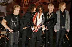 "<p>(L-R) Aerosmith's Joey Kramer, Steven Tyler, Joe Perry, Brad Whitford, and Tom Hamilton attend a press conference for the new video game ""Guitar Hero: Aerosmith"" in New York, June 27, 2008. REUTERS/Lucas Jackson</p>"