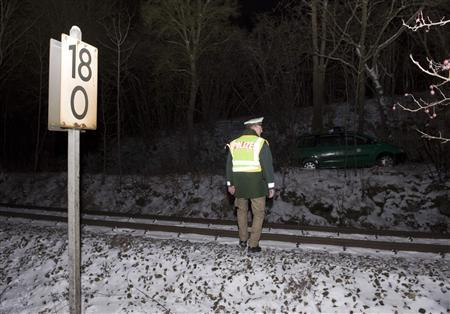 A German police officer walks near the railway track at the site where German billionaire Adolf Merckle committed suicide the previous day near his hometown Blaubeuren, near the southern German city of Ulm January 6, 2009. REUTERS/Wolfgang Rattay