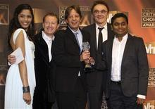 "<p>(L-R) Actress Freida Pinto, writer Simon Beaufoy, producer Christian Colson, director Danny Boyle and composer A.R. Rahman pose together with the award for Best Picture for ""Slumdog Millionaire"" at the 14th annual Critics' Choice awards in Santa Monica, California January 8, 2009. REUTERS/Hector Mata</p>"