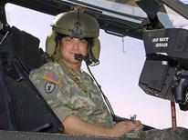 <p>Actor Gary Sinise sits in a U.S. Army Apache helicopter during a tour of the flight line at Contingency Operating Base Speicher in Iraq May 21, 2007. REUTERS/Mike Theiler/Handout</p>