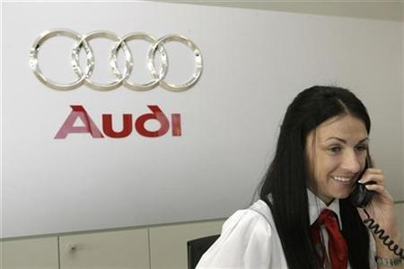 An Audi car dealer and service centre client manager speaks on the phone after the official opening of the centre in Riga in this November 19, 2008 file photo. Audi AG <NSUG.DE> plans to increase marketing spending in the United States by up to 20 percent this year as it aims for a higher share of the world's top luxury-car market, a board member said on Friday. REUTERS/Ints Kalnins