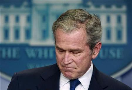 U.S. President George W. Bush pauses during his final news conference in the Brady press briefing room at the White House in Washington, January 12, 2009. REUTERS/Jason Reed