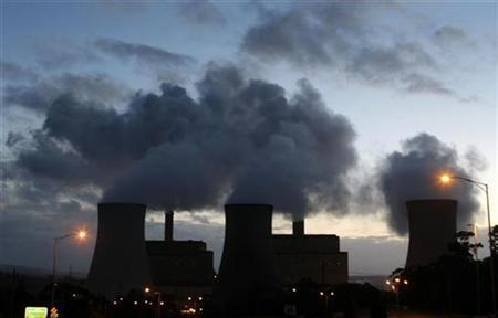 Steam and other emissions are seen coming from the brown coal Yallourn Power Station in the Latrobe Valley near Melbourne December 15, 2008. REUTERS/Mick Tsikas