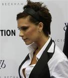 <p>Victoria Beckham presenta la sua linea di abbigliamento in un negozio di Madrid, nell'ottobre del 2008. REUTERS/Andrea Comas</p>