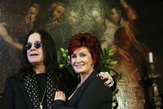 <p>Ozzy and Sharon Osbourne pose in front of some of their belongings to be auctioned in Beverly Hills, California November 26, 2007. REUTERS/Mario Anzuoni</p>
