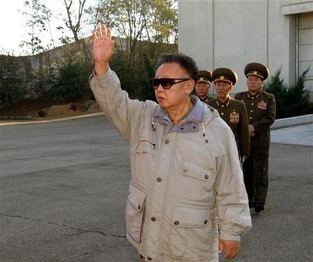 Supreme Commander of North Korean People's Army (front) waves as he visits the 2200 military unit to see military training at an undisclosed place in North Korea, in this undated picture released by KCNA November 5, 2008. REUTERS/KCNA
