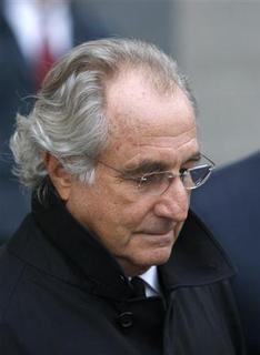 Accused swindler Bernard Madoff exits the Manhattan federal court house in New York January 14, 2009. Madoff can remain out on bail and under house arrest, a U.S. judge ruled on Wednesday, rejecting a government appeal to send him to jail. REUTERS/Brendan McDermid