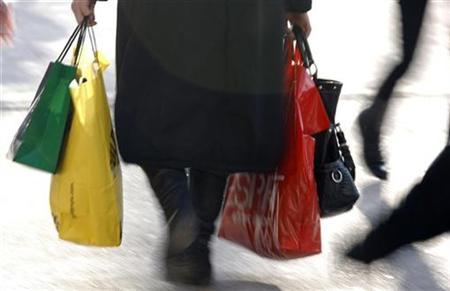 A woman carries shopping bags in Strasbourg during the first day of winter sales in France January 7, 2009. REUTERS/Vincent Kessler