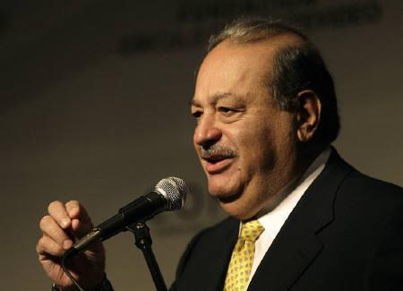 Mexican billionaire Carlos Slim gestures during a summit in Punta del Este in this November 25, 2008 file photo. The New York Times Co. said it will get a $250 million investment from one of the world's richest men, Mexican billionaire Carlos Slim, a move that will give the company much-needed time to clear financial hurdles.  REUTERS/Andres Stapff