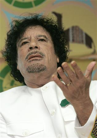 Libyan leader Muammar Gaddafi (R) gestures during a news conference in a tent in Kiev, November 6, 2008. REUTERS/Konstantin Chernichkin
