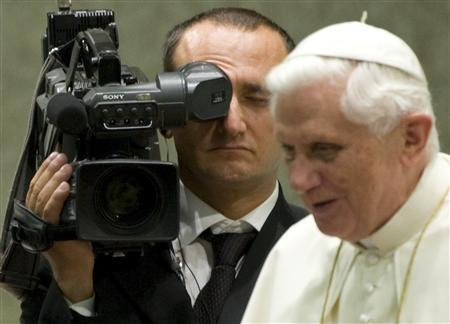 A CTV (Central Television Vatican) cameraman stands near Pope Benedict XVI during a weekly general audience in the Vatican in this August 27, 2008 file photo. REUTERS/Chris Helgren/Files