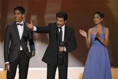 "<p>Actors Dev Patel (L), Anil Kapoor (C) and Freida Pinto accept the award for Outstanding Performance by a Cast in a Motion Picture for ""Slumdog Millionaire"" at the 15th annual Screen Actors Guild Awards in Los Angeles January 25, 2009. REUTERS/Lucy Nicholson</p>"