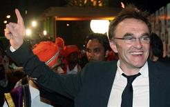 "<p>Danny Boyle, director of Golden Globe award-winning film ""Slumdog Millionaire"", dances as he arrives for his film's premiere in Mumbai January 22, 2009. REUTERS/Punit Paranjpe</p>"