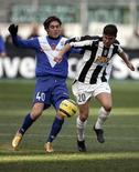 <p>Immagine d'archivio di Mannini quando giocava per il Brescia.. REUTERS/Tony Gentile TG/SM</p>