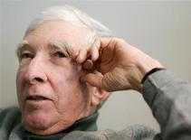 <p>Author John Updike smiles as he is interviewed at the Reuters office in Boston, Massachusetts in this December 12, 2005 file photo. REUTERS/Brian Snyder/Files</p>