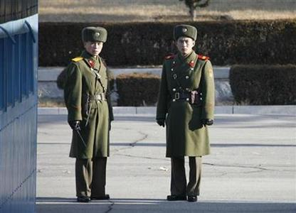 North Korean soldiers look south from the north side of the truce village of Panmunjom in the demilitarised zone (DMZ) separating the two Koreas in Paju, about 55 km (34 miles) north of Seoul, December 3, 2008. REUTERS/Lee Jae-Won