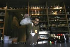 "<p>A bartender serves up a special cocktail known as ""The Madoff Nectar"", a blend of rum, fresh melon juice, triple sec, evaporated milk, syrup and crushed ice, which is part of the ""Carta en Crisis"" or Crisis Menu, at the Catedral bar and grill in Santiago February 3, 2009. A swank bar near Santiago's financial center has tailored its cocktail menu to reflect the global crisis, cutting its prices and coming up with new fruity blends with names like the Subprime, In Recession, Pyramid (scheme), Bailout and Greed. REUTERS/Ivan Alvarado</p>"