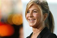 "<p>Cast member Jennifer Aniston smiles at the premiere of the movie ""He's Just Not That Into You"" at the Grauman's Chinese theatre in Hollywood, California February 2, 2009. REUTERS/Mario Anzuoni</p>"