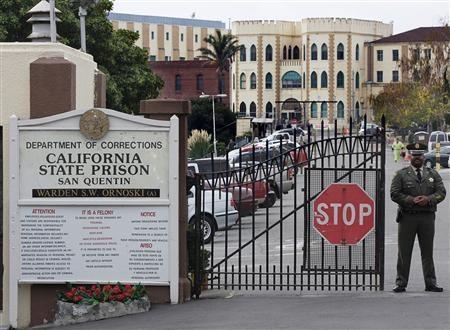 A guard stands at the gate of San Quentin prison in a file photo. REUTERS/Kimberly White