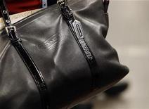 <p>A Coach handbag is seen as a woman stands on a subway platform in New York July 29, 2008. REUTERS/Brendan McDermid</p>
