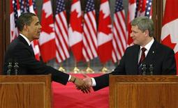 <p>President Barack Obama (L) and Prime Minister Stephen Harper shake hands before a news conference on Parliament Hill in Ottawa, February 19, 2009. REUTERS/Chris Wattie</p>