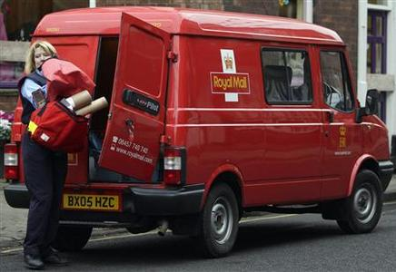A Royal Mail worker removes parcels from her van in Ashbourne, February 24, 2009. REUTERS/Darren Staples