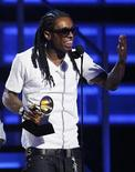 "<p>Rapper Lil Wayne accepts a Grammy for the Best Rap Album for ""Tha Carter III"" at the 51st annual Grammy Awards in Los Angeles February 8, 2009. REUTERS/Lucy Nicholson</p>"