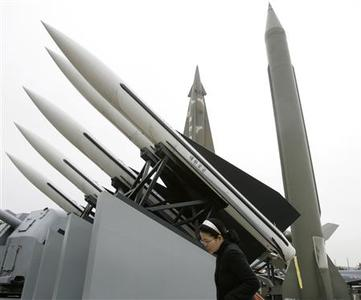 A woman walks past models of a North Korean Scud-B missile (R in the back row), a Nike missile (L in the back row) and Hawk surface-to-air missiles (white ones) at the Korean War Memorial Museum in Seoul February 24, 2009. REUTERS/Jo Yong-Hak