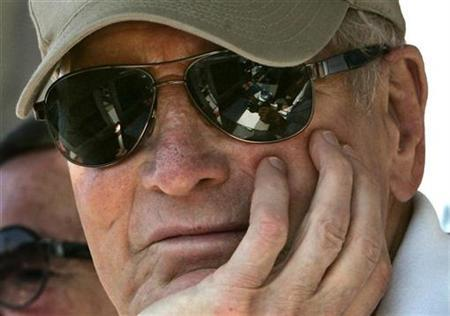 Race Team owner Paul Newman watches qualifying race at Molson Montreal Indy Champ Car race at the Circuit Gilles Villeneuve. Race car team owner and actor Paul Newman watches the qualifying race for the Molson Montreal Indy Champ Car race at the Circuit Gilles Villeneuve August 27, 2005. REUTERS/Christinne Muschi
