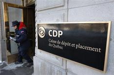 <p>A woman walks out of the Caisse de depot et placement du Quebec head office in Quebec City February 25, 2009. REUTERS/Mathieu Belanger</p>