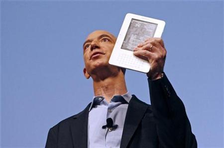 Amazon.com founder and CEO Jeff Bezos holds the new Kindle 2 electronic reader at a news conference in New York where the device was introduced, February 9, 2009. REUTERS/Mike Segar