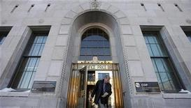 <p>A man walks out of the Caisse de depot et placement du Quebec head office in Quebec City February 25, 2009. REUTERS/Mathieu Belanger</p>