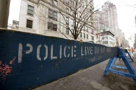 Police barricades are placed along the street outside the home of Bernard Madoff before a protest in New York February 7, 2009. REUTERS/Chip East
