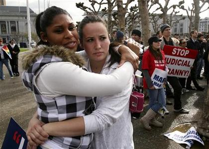 Two women embrace outside the California Supreme Court during a Proposition 8 demonstration in San Francisco, March 5, 2009. REUTERS/Robert Galbraith