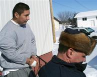 <p>Christopher Pauchay (L) is escorted out of court in Rose Valley, Saskatchewan, March 6, 2009. REUTERS/Rod Nickel</p>