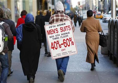 A man wears a sale advertisement as he walks along 5th Avenue in New York, November 19, 2008. Small business owners continue to liquidate inventories and have been using massive price-cutting for months to accomplish the reductions, an NFIB survey said. REUTERS/Mike Segar