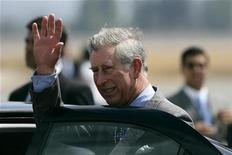 <p>Britain's Prince Charles waves upon his arrival at the Pudahuel airport in Santiago in this file photo from March 8, 2009. REUTERS/Victor Ruiz Caballero</p>