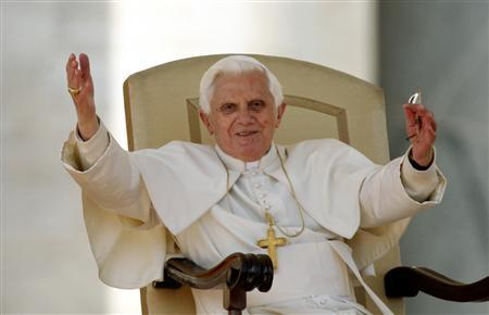 Pope Benedict XVI waves as he leads his weekly audience in St. Peter's Square at the Vatican March 11, 2009. REUTERS/Alessia Pierdomenico