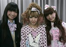<p>Ambassadors of Cute, Shizuka Fujioka (L), Yu Kimura, and Misako Aoki (R), pose during a news conference at Japan's Foreign Ministry in Tokyo March 12, 2009. Ever seen an ambassador dressed from head to foot in pastel frills? How about a diplomatic envoy in a mini-skirted school uniform? In a bid to raise its international profile, Tokyo has appointed three young women as cultural envoys because they represent Japan's long-running craze for all things cute. REUTERS/Michael Caronna</p>