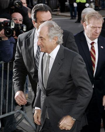 Accused swindler Bernard Madoff (front) enters the Manhattan federal court house in New York, March 12, 2009. REUTERS/Shannon Stapleton