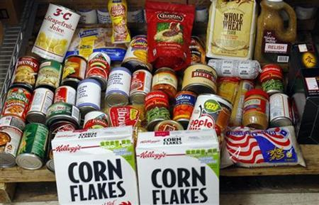One month's food assistance for one to two people is displayed at the Blackstone Valley CAP food pantry in Pawtucket, Rhode Island December 2, 2008. REUTERS/Brian Snyder