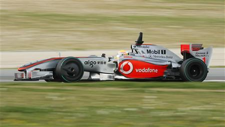 McLaren F1 driver Lewis Hamilton drives his racing car during a testing session at Catalunya's racetrack in Montmelo near Barcelona March 11, 2009. REUTERS/Albert Gea