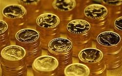 <p>Gold bullion coins known as Krugerrands are pictured in the mint where they are manufactured in Midrand outside Johannesburg October 3, 2008. REUTERS/Siphiwe Sibeko</p>