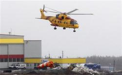<p>A Canadian Search and Rescue helicopter takes off from St. John's March 12, 2009 to search for survivors of a helicopter crash off the coast of Newfoundland. REUTER/Greg Locke</p>
